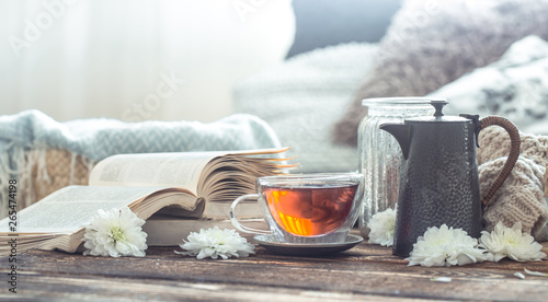 Still life details of home interior on a wooden table with a Cup of tea