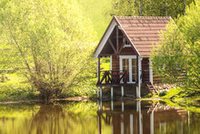 Small Wooden House Near The Pond