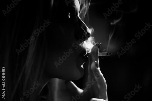 Fototapety, obrazy: Woman smoking a cigarette, black and white,artistic, some photo grain