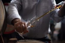 Man, Pouring Cognac From The B...