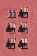 Red Wall With Blinds