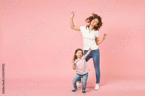 In de dag Dance School Woman in light clothes have fun with cute child baby girl. Mother, little kid daughter isolated on pastel pink wall background, studio portrait. Mother's Day, love family, parenthood childhood concept