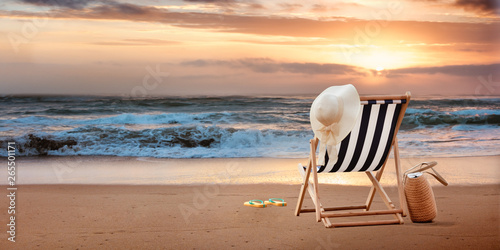 Beach chair with hat on tropic beach Fototapeta