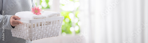 Cuadros en Lienzo Woman holding stack of fresh white bath clean towels in bedroom interior
