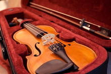 Violin And Bow In Dark Red Cas...
