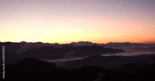 Fototapety, obrazy: Mountain views are complex, with fog and colorful skies during the rising sun.
