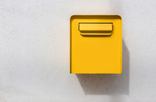 Yellow Mailbox On White Wall. ...