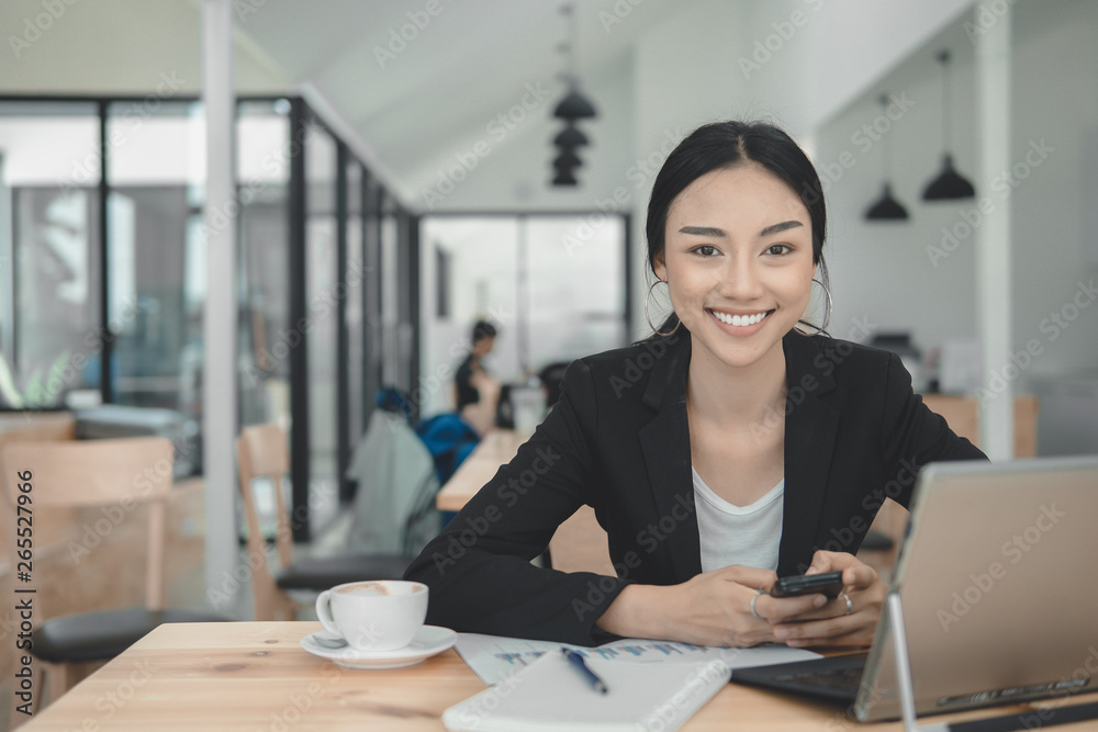 Fototapety, obrazy: Successful business woman working on laptop computer.Typing laptop keyboard on working desk.Business Professional look enjoy working concept.
