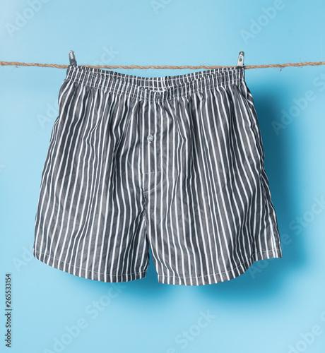 Valokuvatapetti Men's boxer shorts hanging on rope