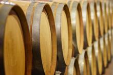 Close Up Of Wine Barrels In Cellar