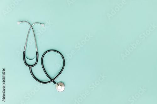 Fotografia  Simply minimal design with medicine equipment stethoscope or phonendoscope isolated on trendy pastel blue background