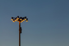 Holophane Streetlights Against Blue Sky