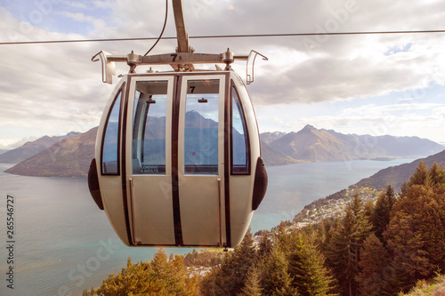 Ski lift overlooking mountain and lake