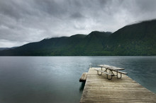 Picnic Table On Wooden Pier At...