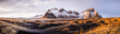 Panoramic view of mountains over remote fields