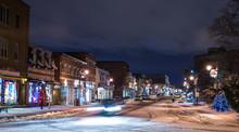 Snow On City Street At Night