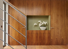 Flowers And Walnut Wall Covering In Home