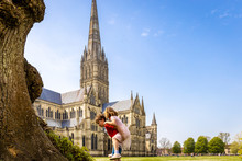 Family At Salisbury Cathedral In Sunny Day