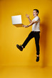 Jumping student with laptop