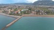 Flying along the beach up high with view of hotels, going south in north in north Denia in Spain