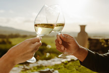 Couple Toasting White Wine In ...