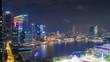 night time illuminated singapore city downtown bay aerial panorama 4k timelapse