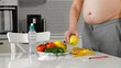 fat man measuring his waist, healthy eating, healthy lifestyle concept, fitness diet
