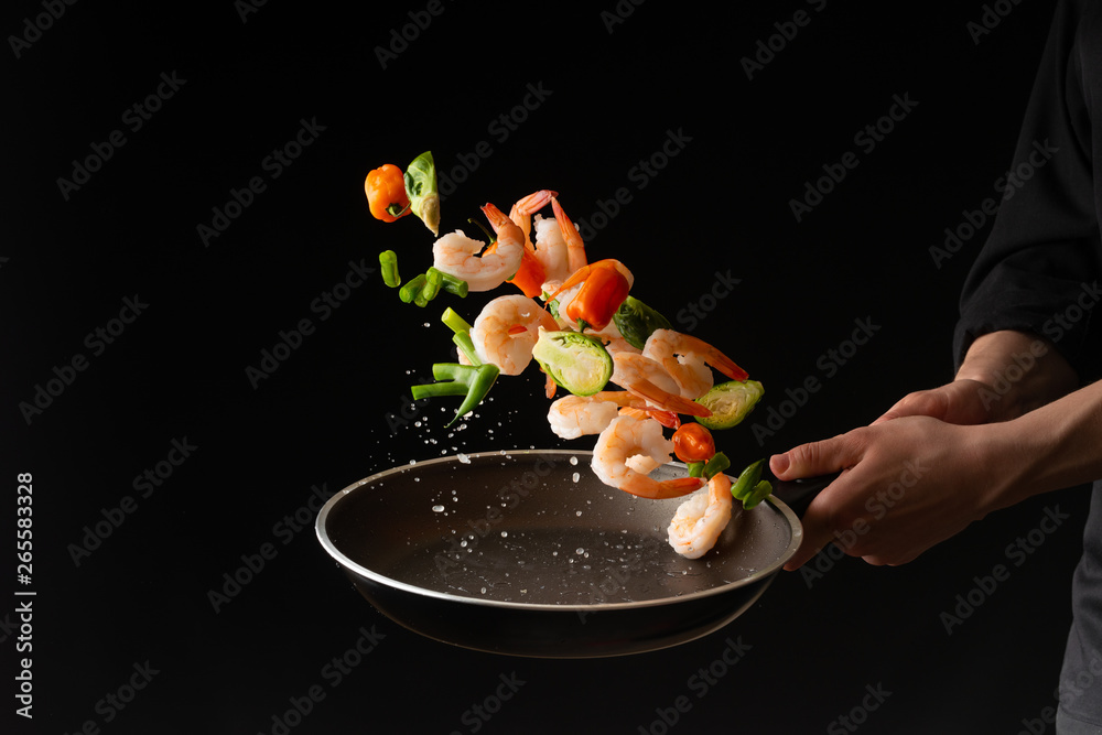 Fototapety, obrazy: Seafood, Professional cook prepares shrimps with sprigg beans. Frost in the air, Cooking seafood, healthy vegetarian food