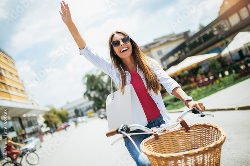 Beautiful woman riding on bike and having fun.