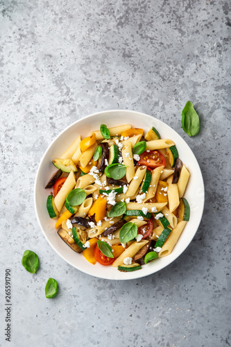 Photo  pasta salad with grilled vegetables ( zucchini, eggplant, bell pepper ant tomato