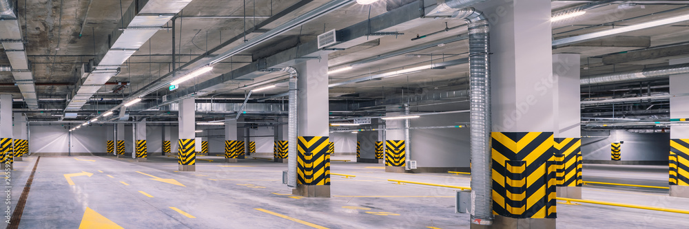 Fototapeta Empty shopping mall underground parking lot or garage interior with concrete stripe painted columns