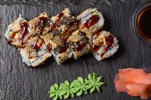 Smoked Salmon Roll Sushi Served On Blackstone