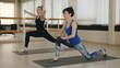 Two girls works with a coach in a fitness gym. Two women in the gym do aerobics. Pilates.