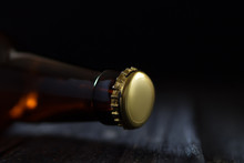Close-up Of Beer Glass Bottle Neck With Lid