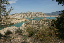 BADLANDS AND BLUE WATER