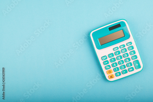 Photo close-up and selective focus shot, calculator on blue background