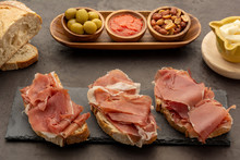 Spanish Ham On Bread With Toasted Peanuts Olives And Tomato Fried