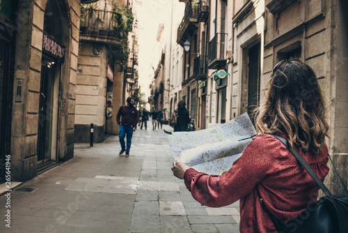 Fototapeta Barcelona, beautiful woman tourist with map on the street obraz