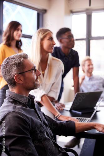 Creative business team listening at a brainstorm meeting, close up, vertical