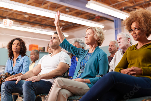 Woman Asking Question At Neighborhood Meeting In Community Center Fototapeta