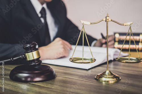 Papiers peints Individuel Judge gavel with Justice lawyers, Gavel on wooden table and Counselor or Male lawyer working on a documents at law firm in office. Legal law, advice and justice concept