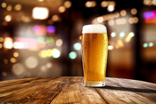 Fresh Cold Beer In Glass And Free Space For Your Bottle. Bar Interior Background