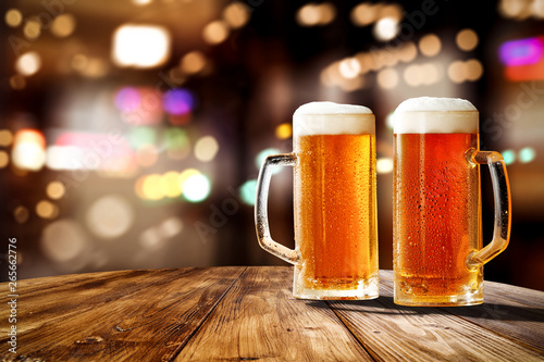 Papel de parede Fresh cold beer in glass and free space for your bottle