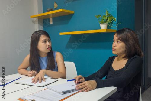 Office women talking about work in office Canvas Print