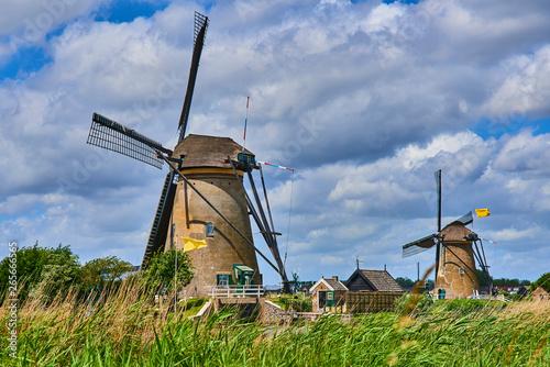 Aluminium Prints Mills Netherlands rural lanscape with windmills at famous tourist site Kinderdijk in Holland. Old Dutch village Kinderdijk, UNESCO world heritage site.