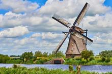 Netherlands Rural Lanscape With Windmills At Famous Tourist Site Kinderdijk In Holland. Old Dutch Village Kinderdijk, UNESCO World Heritage Site.