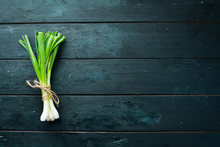 Fresh Green Onion On The Old Background. Top View. Free Space For Your Text.
