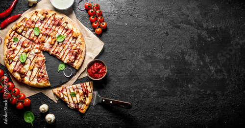 Canvas Prints Pizzeria Barbecue pizza with spinach leaves, cherry tomatoes and cheese sauce.