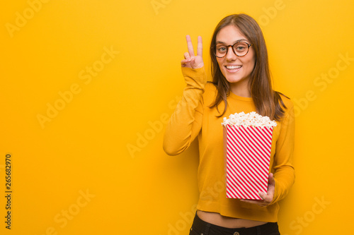 Valokuva  Young pretty caucasian woman fun and happy doing a gesture of victory