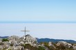 canvas print picture - A wooden cross on top of Formosa mountain peak near Plettenberg Bay, South Africa. Christianity religion concept image.